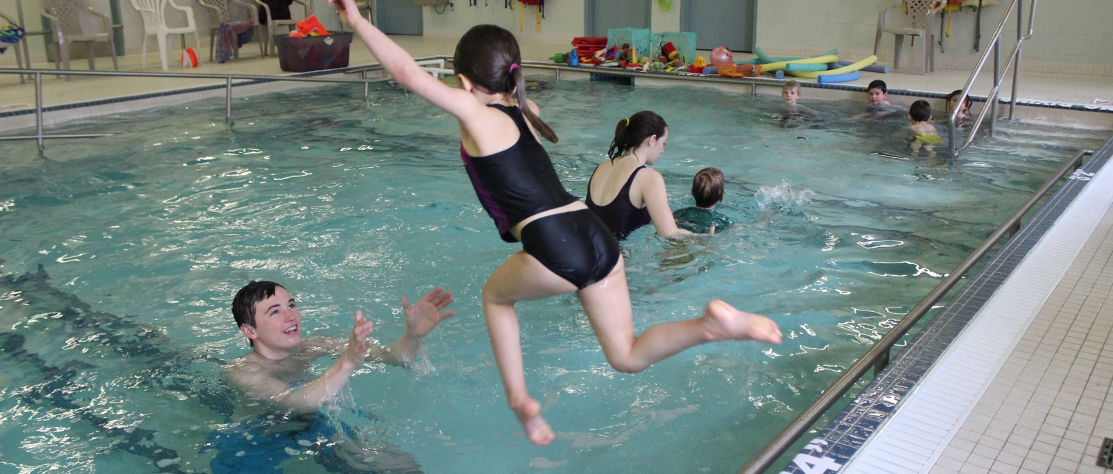 Child leaping into pool