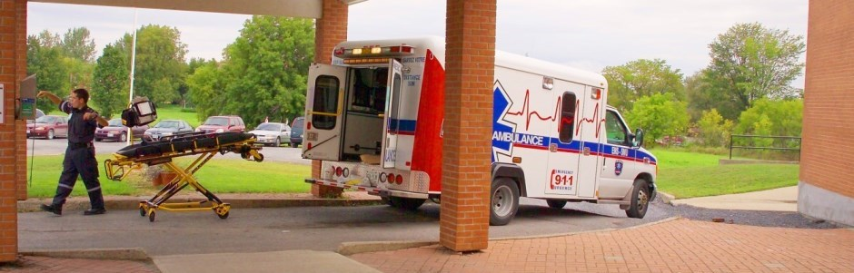 Paramedics by the ambulance at loading entrance